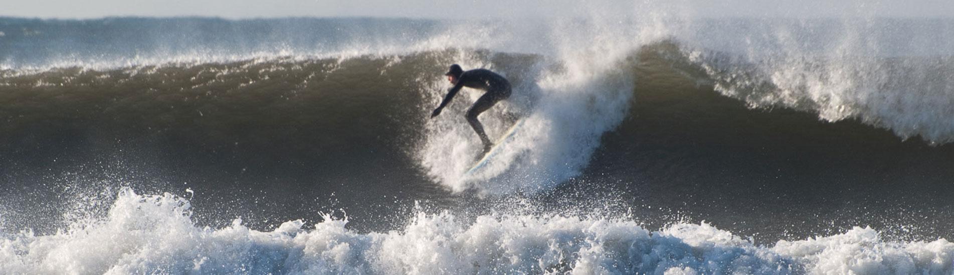 Surfing at Croyde Beach, Devon